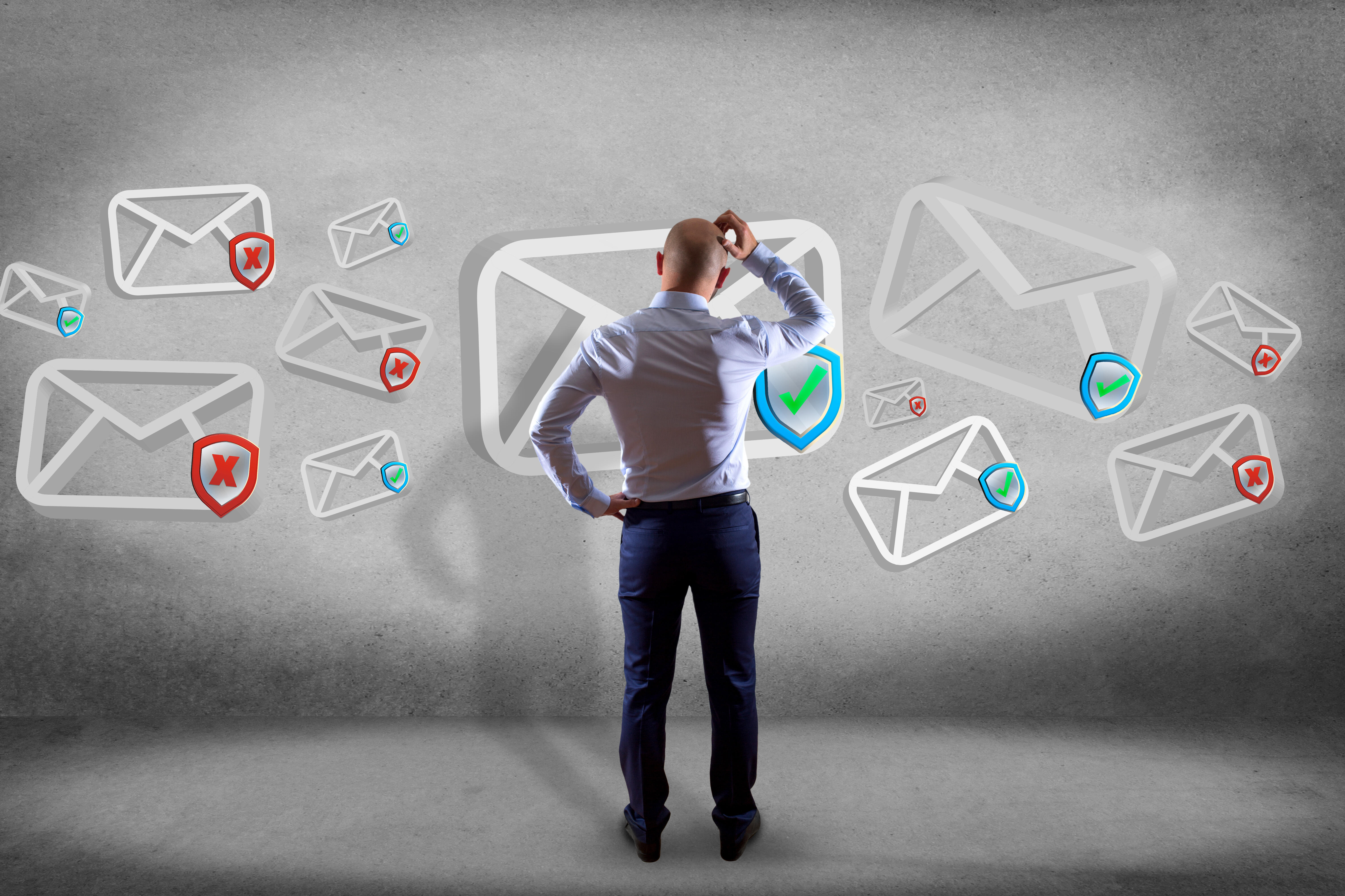 Man viewed from behind looking at email icons in air