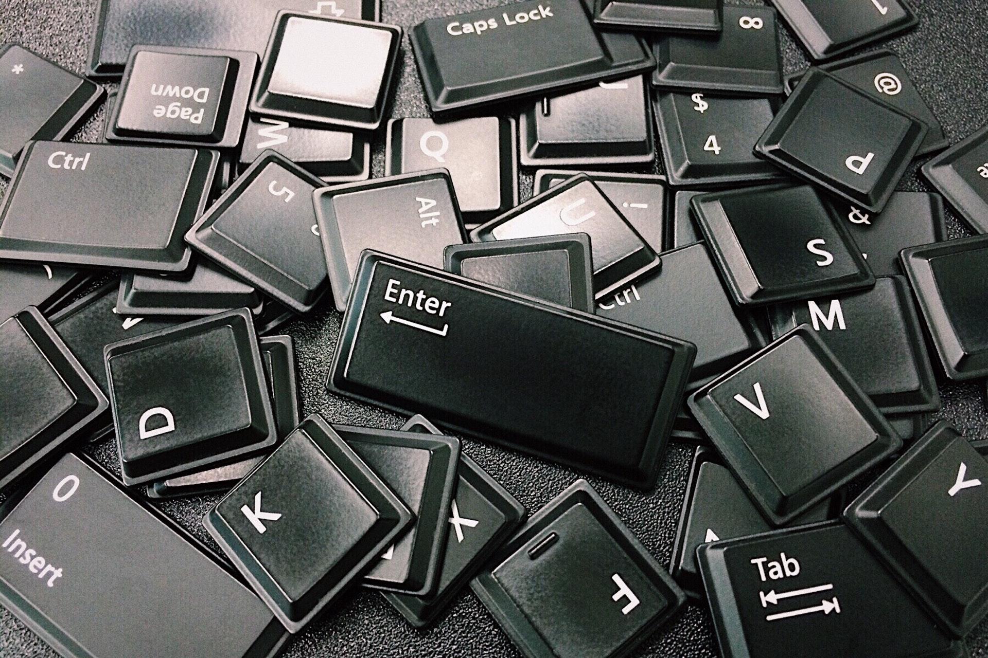 Loose pile of black computer keyboard keys