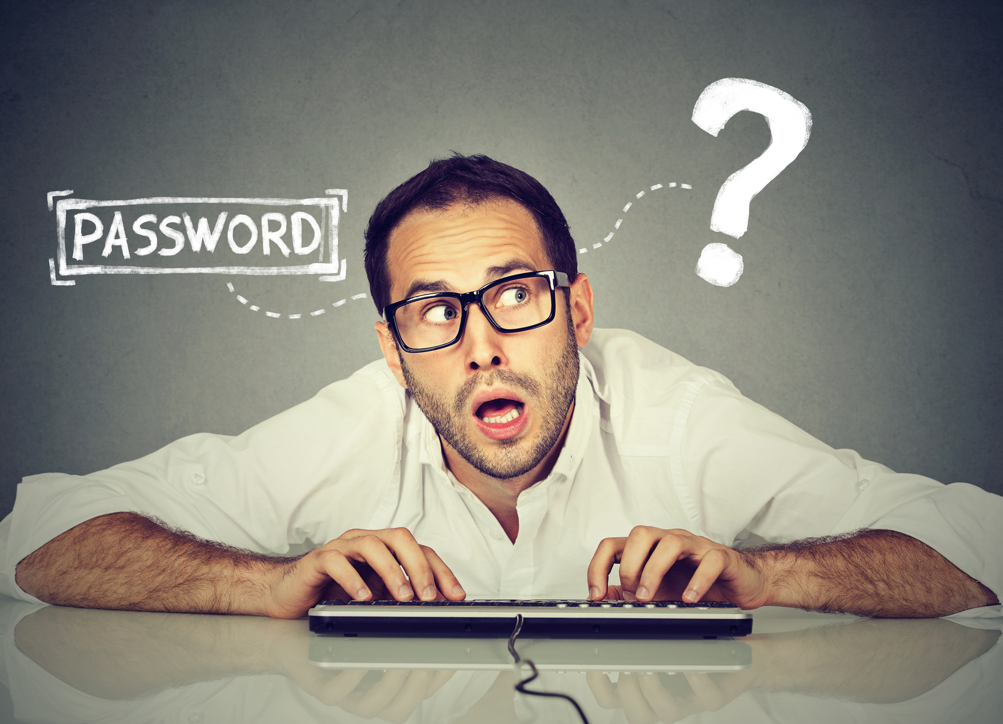 "Man typing on computer keyboard with word ""Password?"" appearing over his head"