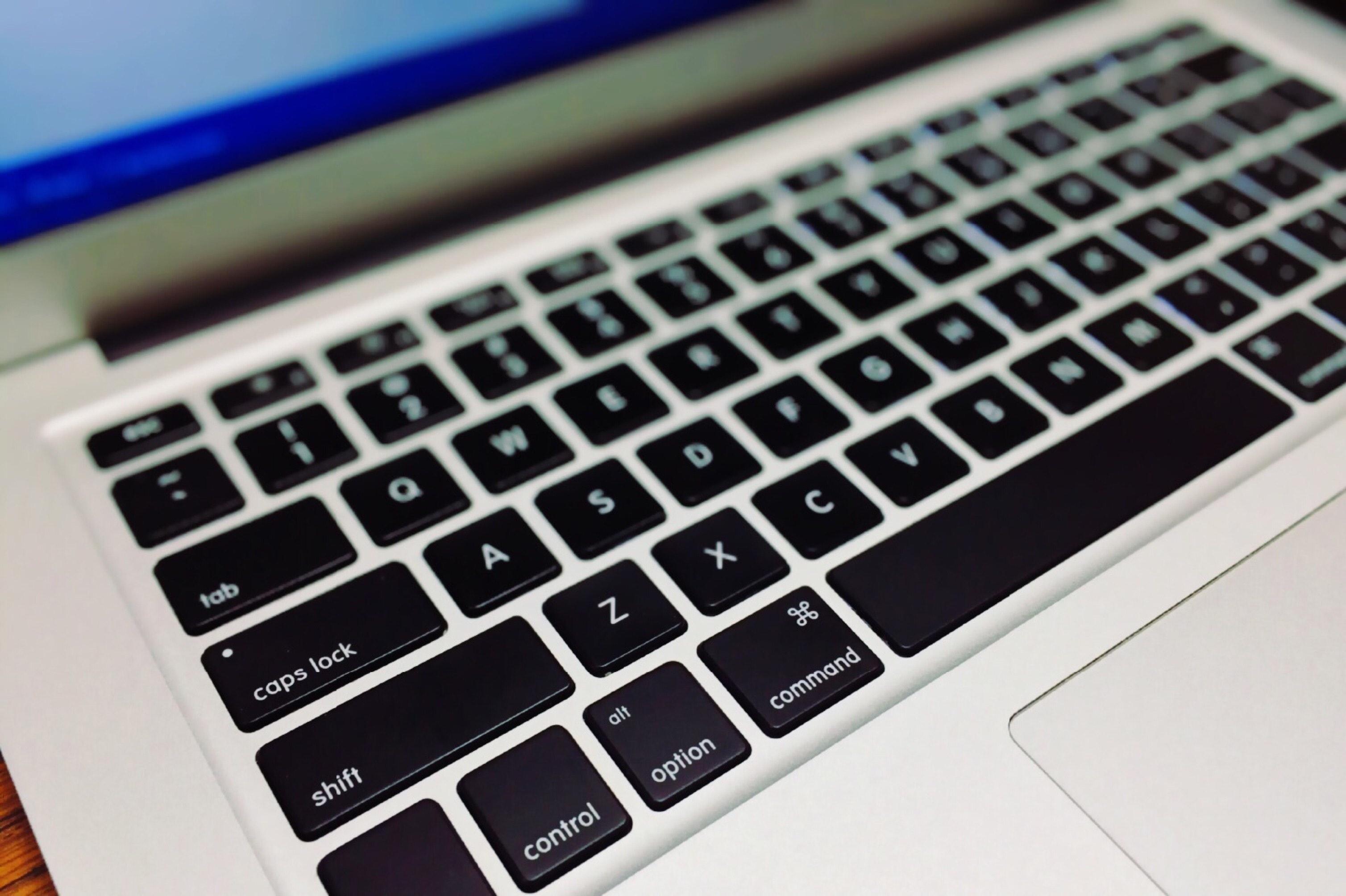 Photo of laptop keyboard showing caps lock key