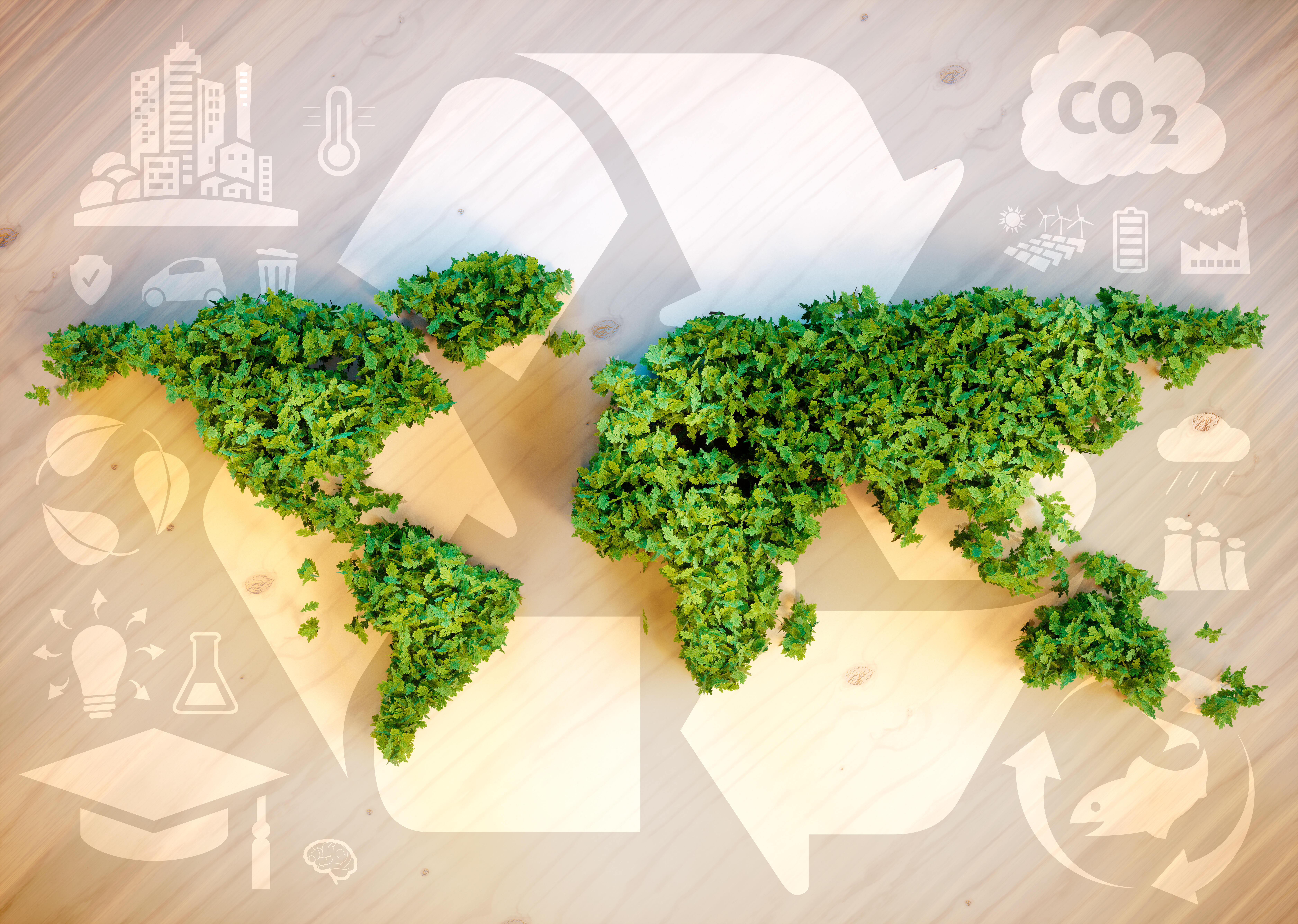 Map of world made of green plants on beige background with recycling symbols